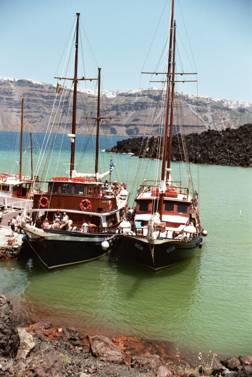 View of boats at Nea Kameni volcano, Santorini